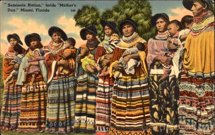 Vintage tourist postcard of Seminole people in strip clothing